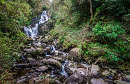 Beautiful Torc waterfall photographed in autumn in Killarney National Park, Ireland
