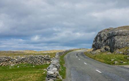 Road through the irish countryside near Burren, Ireland