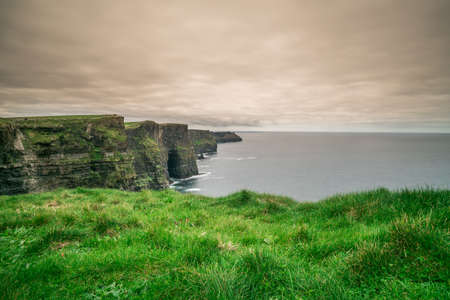 doolin: View over Cliffs of Moher on a overcast, cloudy and gloomy day, Ireland