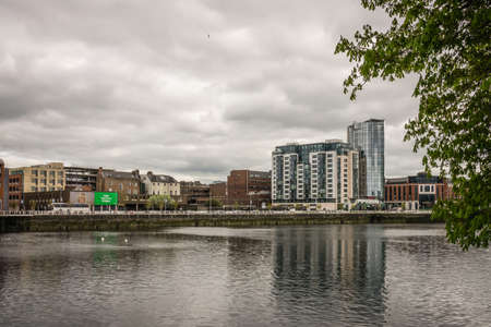 Limerick, Ireland -  April 2017 : View of the Shannon river, hotels, commercial and residential buildings in Limerick, Ireland