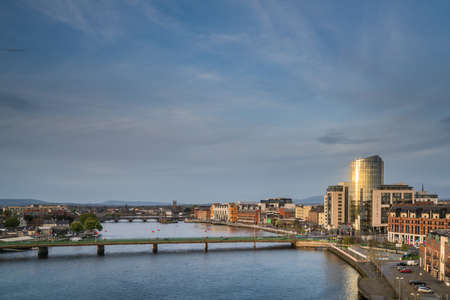 Limerick, Ireland -  April 2017 : Limerick, Ireland -  April 2017 : View of the Shannon river, hotels, commercial and residential buildings in Limerick, Ireland