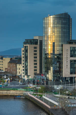 Limerick, Ireland -  April 2017 : Modern glass and steel Riverpoint skyscraper building in Limerick, Ireland