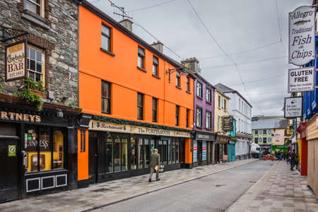 ortseingangsschild: Limerick, Ireland -  April 2017 : Pubs, bars and restaurants in a town in Ireland Editorial