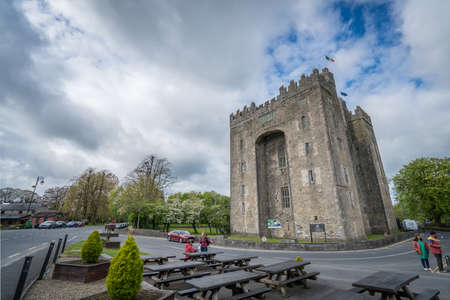 Bunratty castle, Ireland -  April 2017 : Tourists in front of the Bunratty castle on a cloudy day, county Clare, Ireland Editorial