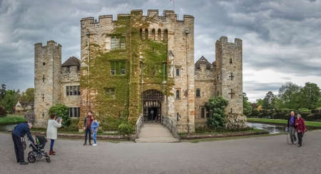 Hever Castle, England -  April 2017 : Tourists in front of the Hever Castle  located in the village of Hever, Kent, built in the 13th century, historical home of Ann Boleyn, the second queen consort of King Henry VIII of England Redakční
