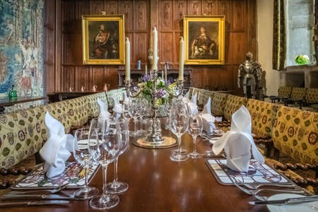 Hever Castle, England -  April 2017 : Dining room in Hever Castle, historical home of Ann Boleyn, the second queen consort of King Henry VIII of England