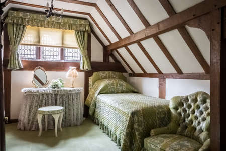 Hever Castle, England -  April 2017 : Small bedroom in Hever Castle, historical home of Ann Boleyn, the second queen consort of King Henry VIII of England