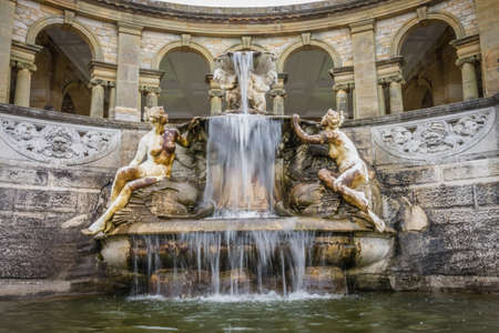 Hever Castle, England - April 2017 : Fountain in the Hevers Castle Italian garden, inspired by the Trevi fountain in Rome. Hever, Kent, England