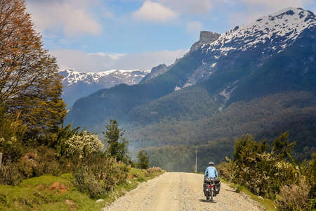 Cyclist climbing up the hill on the Carretera Austral, southern Patagonia, Chile