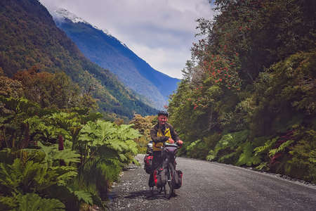 Cyclist on a cycle touring round the world trip pausing for a photo on the Carretera Austral, southern Patagonia, Chile