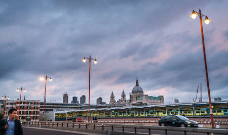 London, England - July 26, 2017 :  People walking over and cars riding on the Blackfriars bridge at dusk, London Editorial