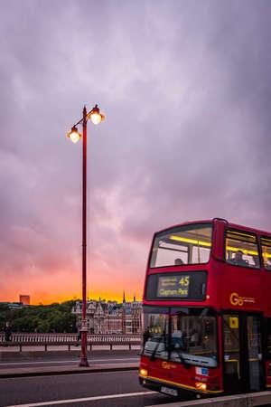 London, England - July 26, 2017 :  London double decker Routemaster driving on the Blackfriars Bridge at dusk, London, England