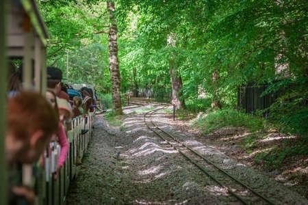 railtrack: London, England - May 2017 : Narrow gauge tourist train going around the Ruislip Lido lake, London, UK