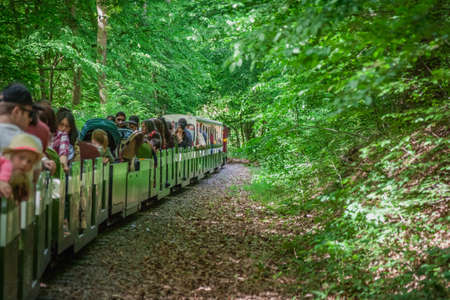 London, England - May 2017 : Narrow gauge tourist train going around the Ruislip Lido lake, London, UK