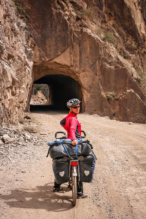 Woman posing for a picture while on a cycle touring trip in Yunnan Province, China photo