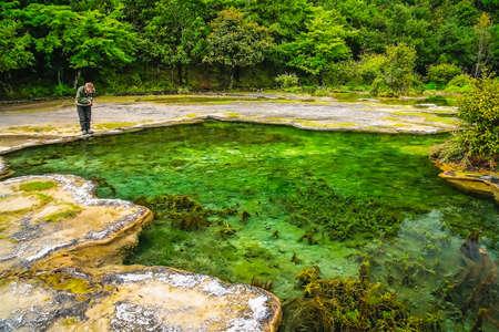 Female tourist admiring the stunningly beautiful Baishuitai Water Terraces, yunnan, China