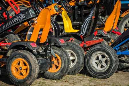 Sarbinowo, Poland -  August 2017 : Colorful Electric mini gocarts to let in a seaside resort