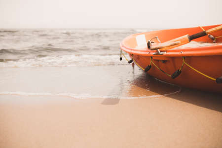 Orange lifeguard rescue boat on the beach in summer