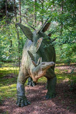 Solec Kujawski, Poland -  August 2017 :  Life sized Stegosaurus dinosaur statue in a forest