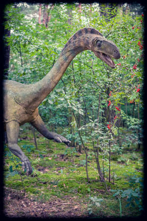 Solec Kujawski, Poland -  August 2017 :  Life sized dinosaur statue in a forest Editorial