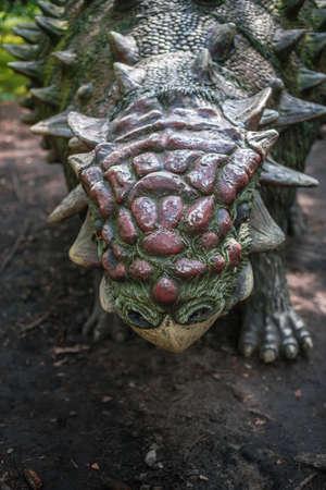 Solec Kujawski, Poland -  August 2017 :  Life sized ankylosaurus dinosaur statue in a forest