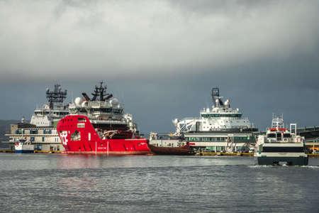 Bergen, Norway -  October 2017 : Large cargo ships in the Bergen port in autumn in Norway