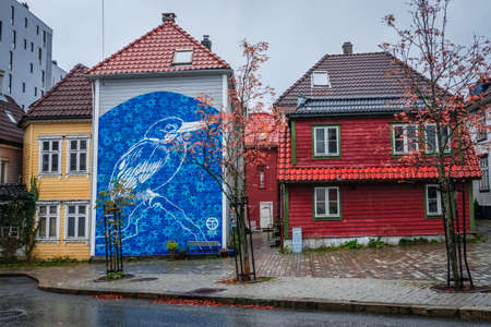 Bergen, Norway -  October 2017 : Large blue bird graffiti art on the wall of a home in Bergen, Norway Editorial