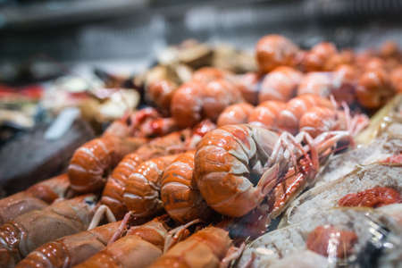 seller: Fresh seafood in cold display on the indoor fish market in Bergen, Norway