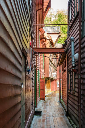Narrow passage between historic wooden buildings in the old town of Bergen, a UNESCO World Heritage list attraction, Norway Editorial