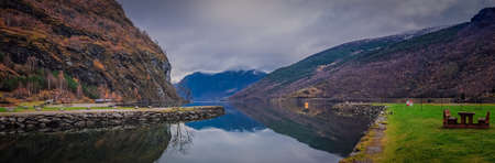 Stunning scenery of norwegian fiord as seen from the shore in small village Flam, Norway Stock Photo