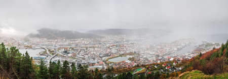 Panoramic view of Bergen town on a cloudy day as seen from the top of Mount Floyen, Norway