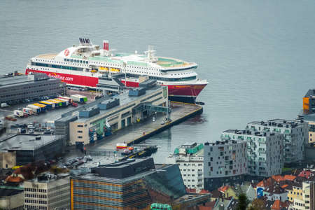 Bergen, Norway -  October 2017 :  Large cargo ship in the Bergen port as seen from the top of Mount Floyen, Norway, Europe