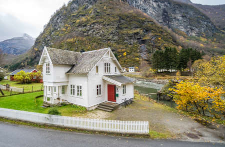Bergen, Norway -  October 2017 :  Traditional cosy white wooden house in a Flam village located in a beautiful mountain valley, Norway Editorial