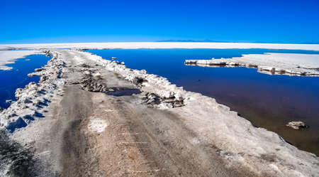 Remote empty road through the Salar de Uyuni in Bolivia