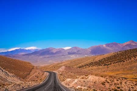 Empty paved road through Nevado Sajama National Park in Bolivia