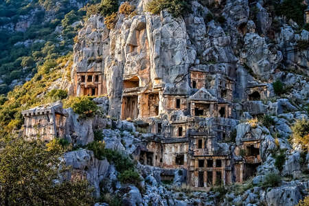 Archeological remains of the Lycian rock cut tombs in Myra, Turkey Stock Photo