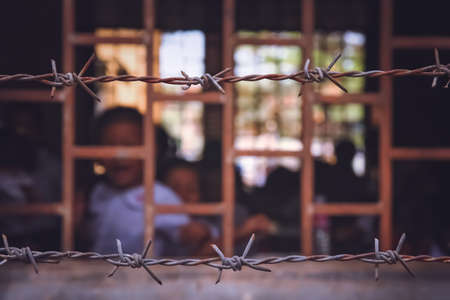 Barbed wire surrounding cambodian school based in the former prison, Phnom Penh, Cambodia Reklamní fotografie
