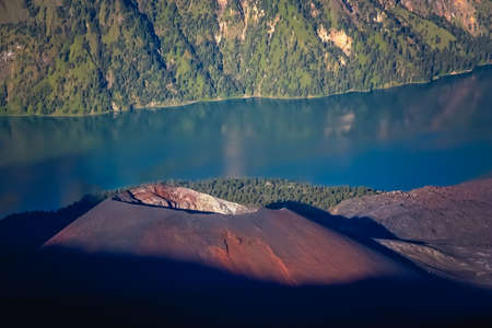 The cone and torquise lake inside the caldera of Gunung Rinjani volcano in Lombok island,  Indonesia
