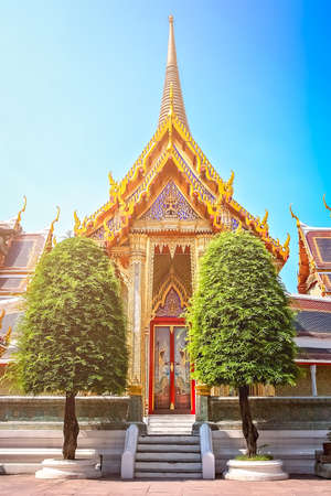 Golden entrance to the beautiful Buddhist temple in Bangkok, Thailand, Asia Stock Photo
