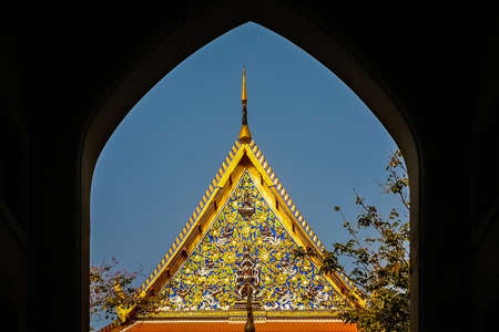 Ornate golden triangular roof of a Buddhist temple in Bangkok, Thailand, Asia
