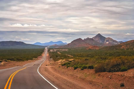 Famous Ruta 40 called also Ruta Quarenta passing through some impressive and strangely shaped mountains in Argentina, South America