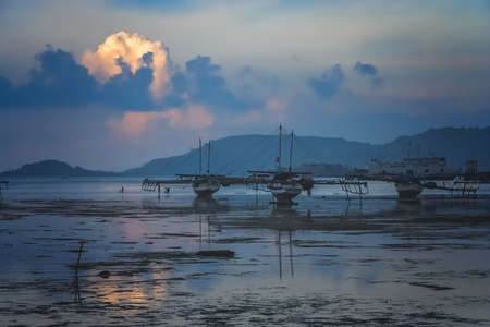 Moored boats after sunset in a small fishing village Sape in Sumbava Island, Indonesia Stock Photo