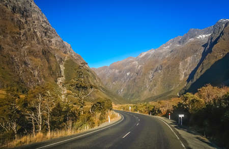 Spectacular mountain road leading to the Milford Sound, New Zealand