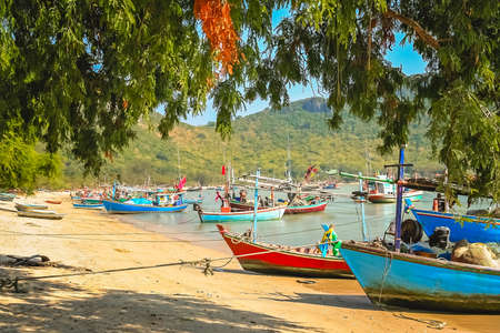 Traditional wooden fishing boats on the beach in Thailand, Asia Stock Photo