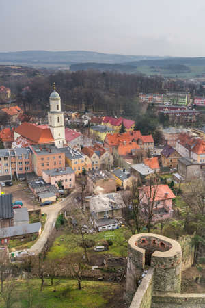 Church tower and colorful tenement houses in the small Bolkow town in Lower Silesia, Poland, as seen from the walls of the Bolkow castle Banque d'images