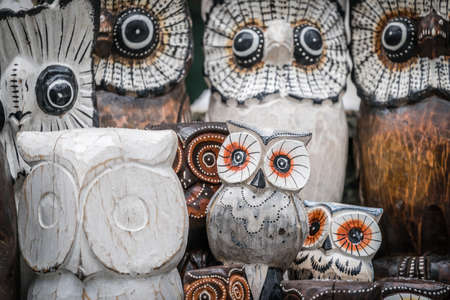 Wooden owls for sale in the street market in Karpacz, Poland