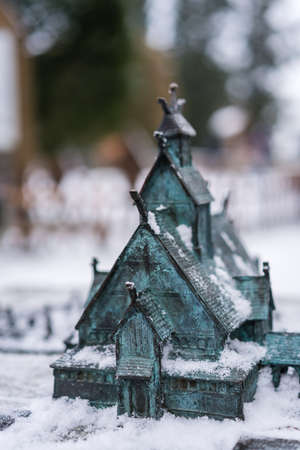 The miniature model of the medieval Wang Temple in Karpacz, Poland, photographed in winter. It is a Norwegian stave church which was transferred to Karkonosze mountains. Stock Photo