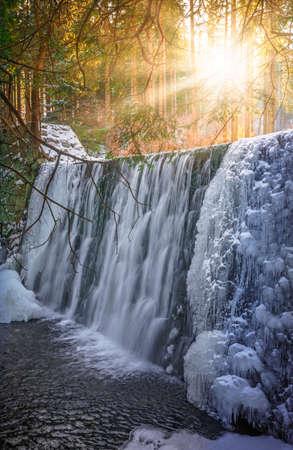 Wild Waterfall, known as Dziki Wodospad, in beautiful scenery of Karkonosze Mountains in Karpacz, Poland, photographed in winter