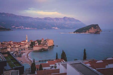 Sunset over the popular summer resort town Budva on the Adriatic coast in Montenegro