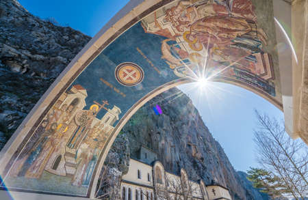 Arched gates with beautiful mosaics at the entrance to the Ostrog Monastery, Montenegro